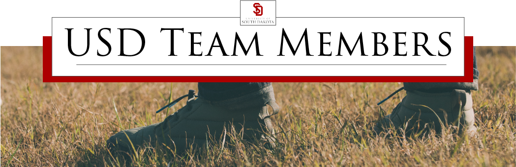 the words 'USD Team Members' with the USD logo above and a photo of a pair of feet standing in a field below